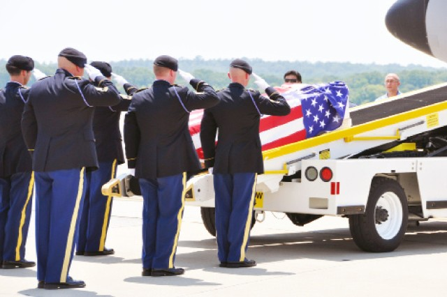 Soldiers from the U.S. Army Marksmanship Unit place the casket of Sgt. 1st Class Jason Sargent on a loading vehicle at Lawson Army Airfield in preparation for his final flight home to his native Maine. Sargent, 39, died June 25 from cancer.