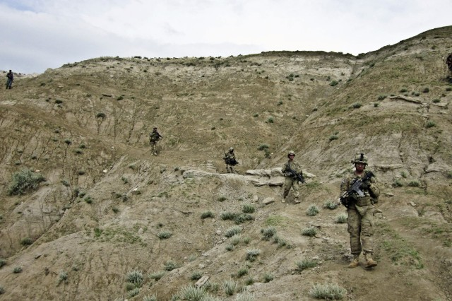 Red Bull Soldiers from Company B, 1st Battalion, 133rd Infantry, along with Afghan National Army and Afghan National Civil Order Police patrol the Galuch Valley area outside the Bad Pech district center in Laghman province, Afghanistan.