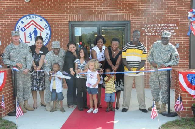 Fort Stewart-Hunter Army Airfield Garrison Commander Col. Kevin Milton joined Dagmar Peguero-Olinger, Maj. Terrance Barr and Family, Bria Caruthers, Isabelle Lopez-Guerro, Genevieve Stone, Darnie Hampton, Nick Johnson and Garrison Command Sgt. Maj. James Ervin in cutting the ceremonial ribbon at the Davis Ave. Child Development Center grand opening, June 23. The 144 capacity CDC is one of three that have opened in the past 24 months and was funded by the Army Family Covenant.