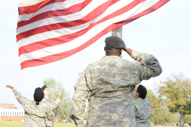 Soldiers from 1st Aviation Brigade Headquarters and Headquarters Company perform the Retreat ceremony at Howze Field. The ceremony is conducted daily at 5 p.m.