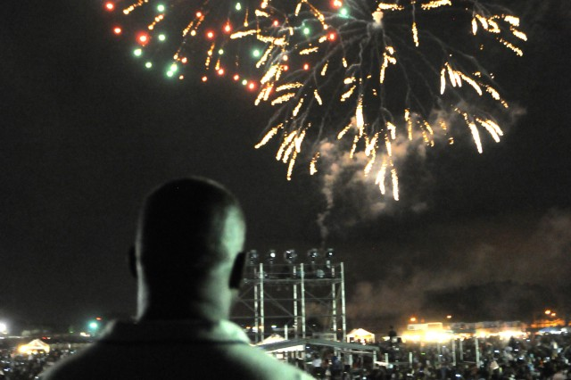 Command Sgt. Maj. Edd Watson, command sergeant major for the 3rd Infantry Division, looks across Donovan Field and watches the fireworks show that brought Fort Stewart's Independence Day Celebration to a close July 4.