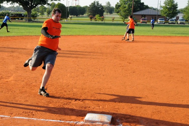 Josh Blackburn, AFS-Cairns Field shortstop, rounds third base on his way to home plate in the team's game against reigning Fort Rucker Intramural Softball champions Old Skool June 30.