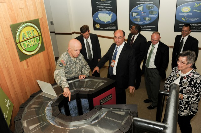 Maj. Gen. Nick Justice, commanding general of U.S. Army Research, Development and Engineering Command, leads a tour for MITRE reprentatives June 30 at Aberdeen Proving Ground, Md.
