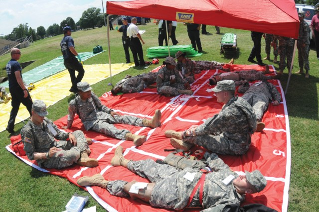Military role players await treatment from medical personnel.