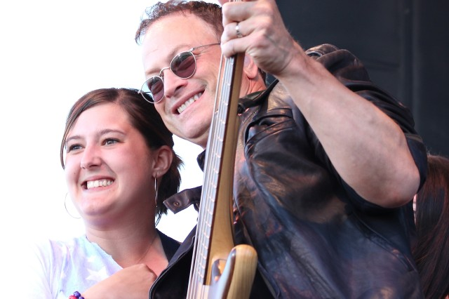 Actor Gary Sinise poses for a photo with a fan onstage in the middle of the Lt. Dan Band concert during Freedom Fest.