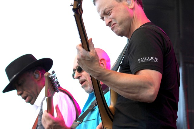 """Kimo Williams, left, Ernie Denov, middle, and Gary Sinise bring Journey's 1981 single """"Don't Stop Believin'"""" to a guitar crescendo Monday night near the end of the Lt. Dan Band's show during Freedom Fest on JBLM. The band plays about 40 concerts a year, most of them for military audiences."""