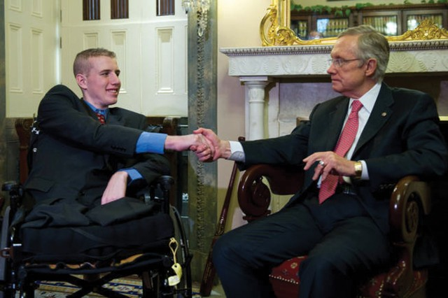Senate Majority Leader Harry Reid meets with Spc. Timothy Hall Jan. 25 before the State of the Union.