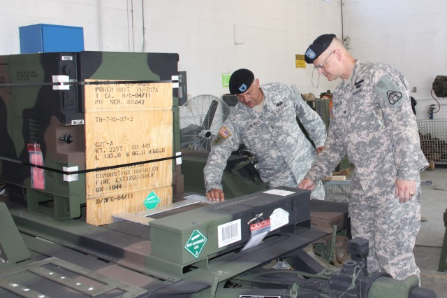Chief Warrant Officer 4 Samuel Tatalovich, West Virginia National Guard, (left) gave Col. William C. Hoppe, project manager for Warfighter Information Network-Tactical, a tour of the West Virginia Army National Guard maintenance facility in Eleanor, W.V., on June 7, 2011.