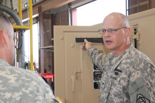 Col. William C. Hoppe, project manager for Warfighter Information Network-Tactical, discussed the work done for his organization by the West Virginia Army National Guard at its maintenance facility in Eleanor, W.V., on June 7, 2011.