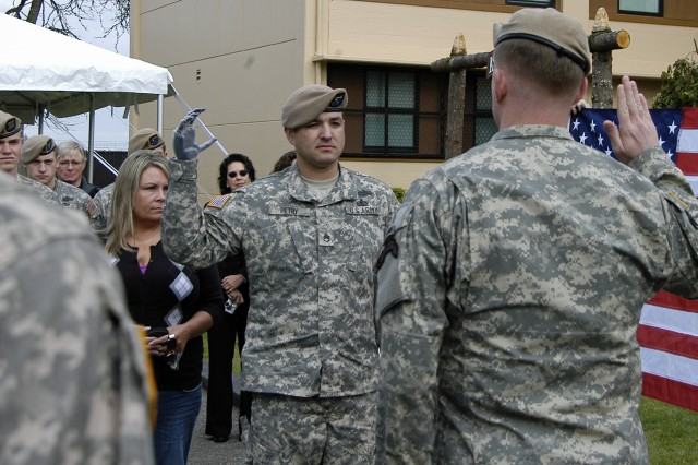Then-Staff Sgt. Leroy Petry re-enlists with the Rangers during a ceremony in May 2010 at Fort Lewis, Wash.