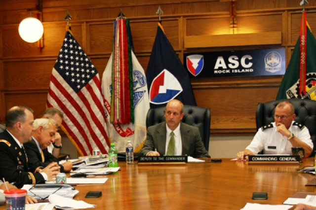 "Scott Welker (center), deputy to the commander, and Maj. Gen. Yves J. Fontaine (right), commanding general of Army Sustainment Command, lead discussion during ASC's June 30 ""Directorate of Logistics Day."""