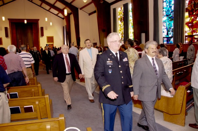 Chaplain (Lt. Col.) Don Campbell and Deputy Garrison Manager Martin Venturo leave the Chapel for the last time June 29 when the Chapel was decommissioned.