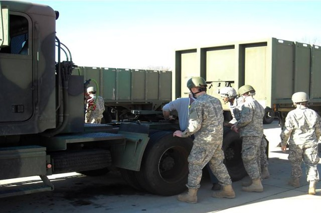Students receive instruction using the M915 tractor semi-trailer during the Mobile Transport Operator Course at Fort Leonard Wood, Mo. The 58th Transportation Battalion, 3rd Chemical Brigade, volunteered to conduct the Smart Training pilot program for the Training and Doctrine Command. The course is responsible for training 75 percent of the Army's drivers.
