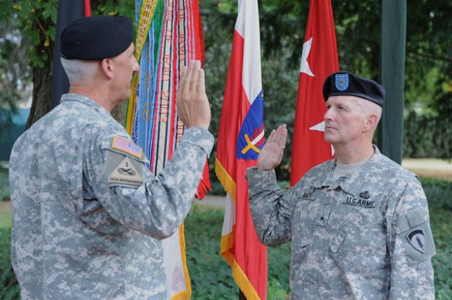 Lt. Gen. Mark P. Hertling, U.S. Army Europe commanding general, administers the oath of office to Brig. Gen. Charles R. Bailey, USAREUR command chaplain, after Bailey was promoted during a ceremony at the Campbell Barracks, July 7. Bailey, a Fort Worth, Texas, native, will assume duties as the deputy chief of chaplains for the U.S. Army.