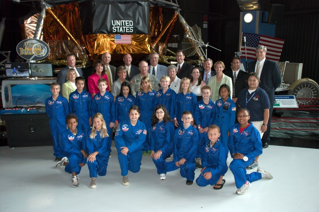 Members of the Air, Space, and Missile Defense Association have their picture taken with the 16 recipients of the ASMDA Space Camp Scholarship. Since 1996, ASMDA has sent 173 students to Space Camp.