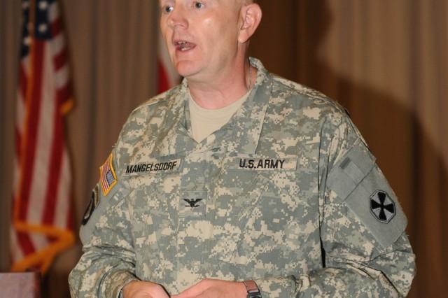 Col. Geoffrey Mangelsdorf speaks at the 3rd Annual Eighth Army Communication Security Workshop July 7.
