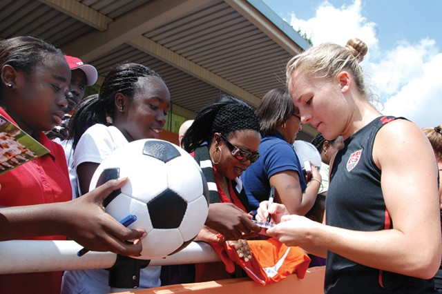 U.S. Women's National Team defender Amy Rodriguez signs autographs for Stuttgart fans Hilary (from left) and Mardi Adrinkrah during an open practice June 30, 2011, in Heidelberg, Germany.