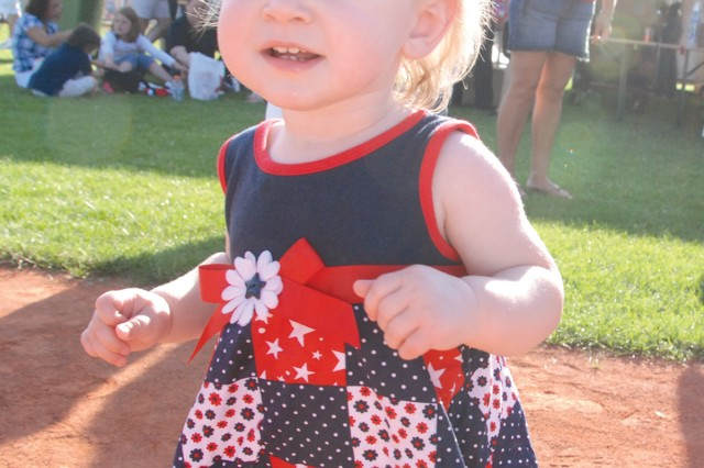 A toddler shows off her red, white and blue duds at U.S. Army Garrison Stuttgart's July 4 celebration on Patch Barracks.