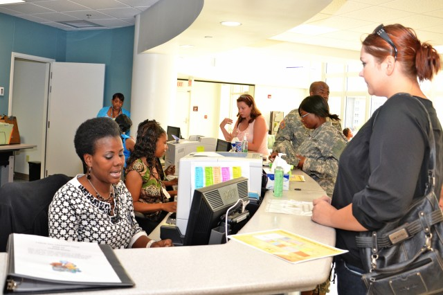 Michelle Knight (left), checks a patient in at CRDAMC's new Women's Health Center. Although they may see hundreds of patients a day, Knight and the other medical support specialists work hard to provide the best customer service possible, striving for positive comments back from patients through the Army Provider Level Satisfaction Survey or Interactive Customer Evaluation (ICE) programs. (U.S. Army photo by Patricia Deal, CRDCAMC Public Affairs)
