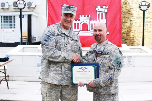 Timothy Anderson (right), an engineering technician deployed to the U.S. Army Corps of Engineers Afghanistan District-North from the USACE Europe District, receives his award from AED-North Commander Col. Thomas H. Magness July 9.