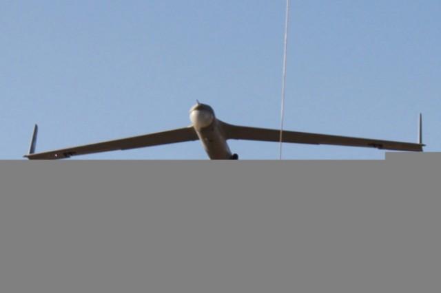 A ScanEagle flies into a retrieval wire at Camp Taji, Iraq.