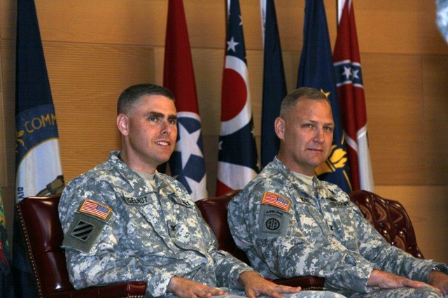Col. David Moore, right, passed leadership of Project Manager Battle Command to Col. Jonas Vogelhut, left, on July 8, 2011. The change of charter event also marked the transition of PM Battle Command to PM Mission Command, a name change that reflects the Army's most recent doctrine, the centrality of the commander, and the focus on fielding capabilities suitable for full-spectrum operations.
