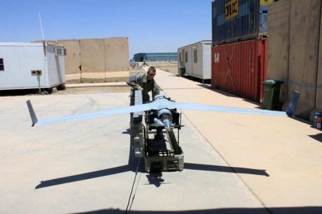 Sgt. Michael Diamondson, the mission commander for ScanEagle Operations, is seen here at Camp Taji, Iraq, with a ScanEagle unmanned aerial system.