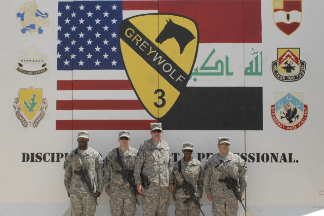 CONTINGENCY OPERATING BASE ADDER, Iraq – Maj. Gen. Eddy M. Spurgin, commander, 36th Infantry Division, United States Division-South, with GREYWOLF awardees in front of Headquarters and Headquarters Troop, 3rd Advise and Assist Brigade, 1st Cavalry Division, at Contingency Operating Base Adder, Iraq, June 27, 2011.