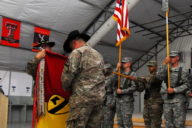 CAMP MARMAL, Afghanistan -- Col. John Novalis, commander, 1st Air Cavalry Brigade, 1st Cavalry Division, and Command Sgt. Maj. Glen Vela, 1st ACB, uncase the brigade's colors during a transfer of authority ceremony July 1. During the ceremony, the brigade officially took charge of U.S. aviation operations in northern Afghanistan, a role previously held only by the outgoing unit, the 4th Combat Aviation Brigade, 4th Infantry Division.