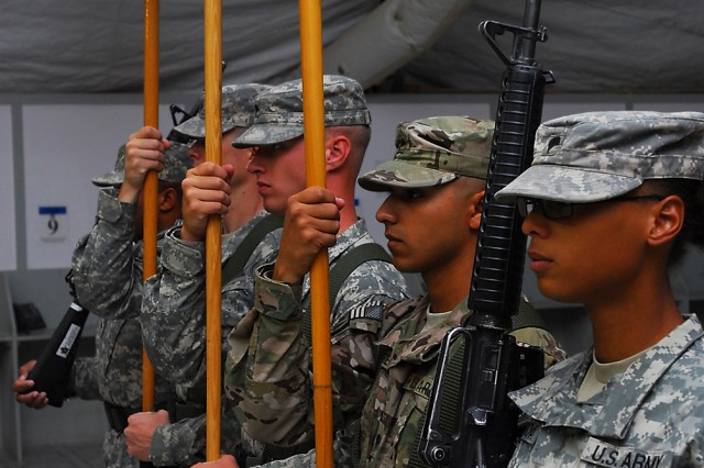 CAMP MARMAL, Afghanistan -- Soldiers from the 1st Air Cavalry Brigade, 1st Cavalry Division, and the 4th Combat Aviation Brigade, 4th Infantry Division, stand at the position of attention as part of the color guard for a transfer of authority ceremony July 1. During the ceremony, the outgoing unit, the 4th CAB, cased its colors in preparation for its return to the United States. The incoming unit, the 1st ACB, uncased its colors and took charge of U.S. aviation operations in northern Afghanistan.
