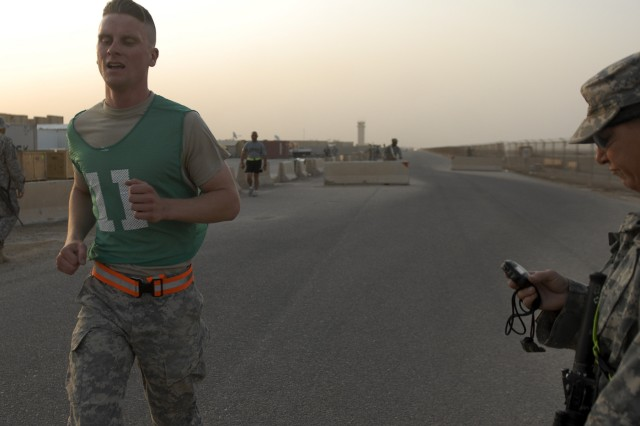 CONTINGENCY OPERATING BASE ADDER, Iraq -- Spc. Cory Penven, a scout with 6th Squadron, 9th Cavalry Regiment, 3rd Advise and Assist Brigade, 1st Cavalry Division sprints across the finish line of a two mile run during 36th Infantry Division's NCO and Soldier of the Quarter Competition on Contingency Operating Base Adder July 1, 2011. Penven received an Army Commendation Medal for winning the Soldier of the Quarter Award.