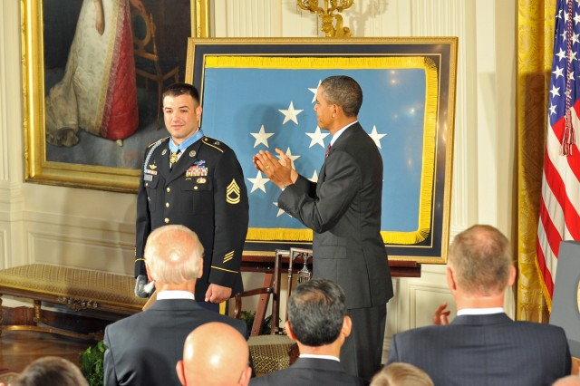 Medal of Honor recipient Sgt. 1st Class Leroy A. Petry receives a standing ovation from President Barack Obama and guests in the east room of the White House, July 12, 2011.