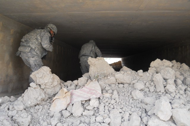 Combat engineers with 1st Platoon, Company C., 3rd Brigade Special Troops Battalion, 3rd Advise and Assist Brigade, 1st Cavalry Division, conduct a dismounted route clearance of a drainage culvert. Clearing these passageways denies the enemy the ability to emplace deep-buried improvised explosive devices under main supply routes.