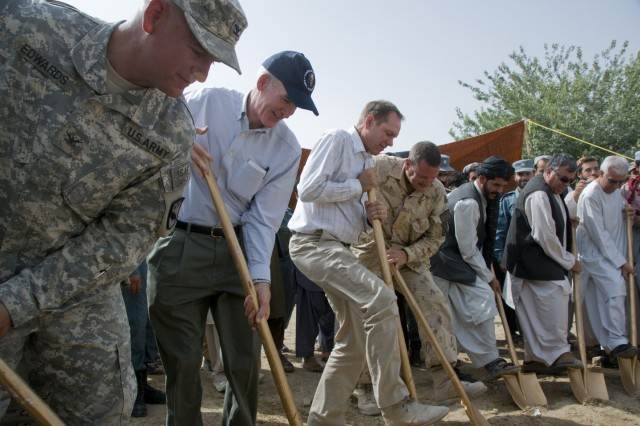 Col. James Edwards, commander, 525th Battlefield Surveillance  Brigade, and representatives from the U.S. State Department,  Canada and the Weesh district government, break ground for   the customs depot expansion project in Weesh, July 6.