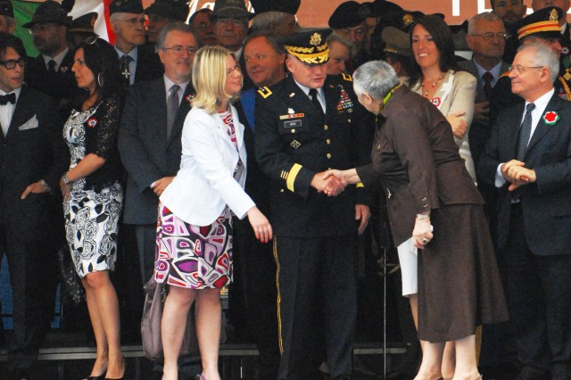 Maj. Gen. David R. Hogg (center) greets former President of the Province of Vicenza, Manuela Dal Lago, at the Italian National Day ceremony in Vicenza's Piazza del Signore, June 2.