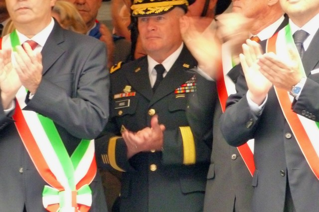 Mayor of Vicenza, Achille Variati (lef) and Maj. Gen. David R. Hogg, U.S. Army Africa commander, join other dignitaries at Italian National Day festivities June 2, 2011 in Vicenza, Italy.