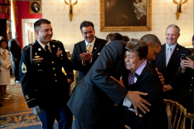 President Barack Obama hugs Bertha Petry, the grandmother of Sgt. 1st Class Leroy Arthur Petry, U.S. Army, in the Blue Room of the White House, July 12, 2011. The President later awarded Sgt. 1st Class Petry, left, the Medal of Honor for his courageous actions during combat operations against an armed enemy in Paktya, Afghanistan, in May 2008.