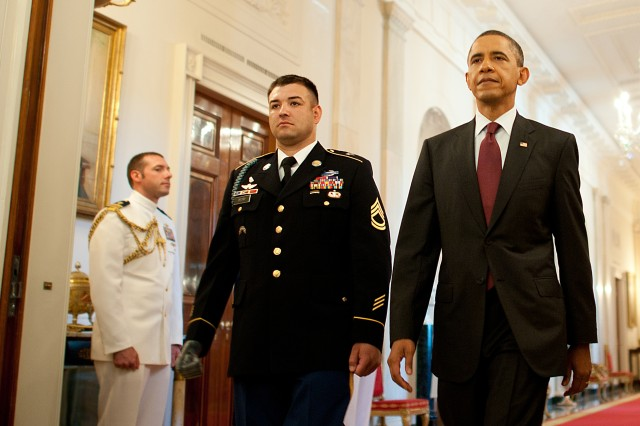 President Barack Obama and Army Sgt. 1st Class Leroy Petry make their way into the East Room for a Medal of Honor presentation ceremony at the White House, July 12, 2011.
