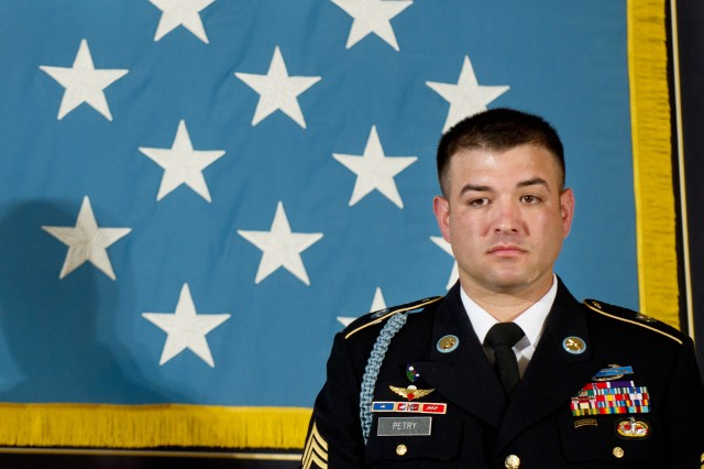 Army Sgt. 1st Class Leroy Petry listens to a description of his actions by President Barack Obama during a Medal of Honor ceremony at the White House in Washington, D.C., July 12, 2011.
