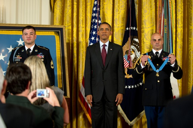 President Barack Obama stands at attention prior to presenting the Medal of Honor to Army Sgt. 1st Class Leroy Petry at the White House in Washington, D.C., July 12, 2011.