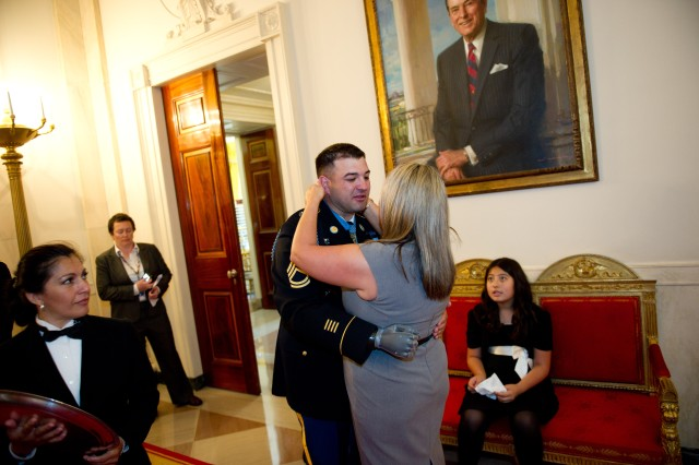 Army Sgt. 1st Class Leroy embraces his wife, Ashely, after he received the Medal of Honor at the White House in Washington, D.C., July 12, 2011.