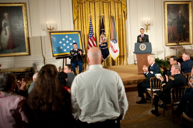 The surviving family members of Army Spc. Christopher Gathercole stand after being acknowledged by President Barack Obama during Army Sgt. 1st Class Leroy Petry's Medal of Honor ceremony in Washington D.C., July 12, 2011. Gathercole was killed in Afghanistan in the same attack for which Petry received his Medal of Honor.