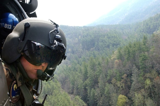 The Active Guard Reserve allows active-duty Soldiers to transfer to locations closer to home, where their skills can be put to good use. Here, a Soldier from the North Carolina Army National Guard peers from a UH-60 Black Hawk during a recent search and rescue exercise near Morganton, N.C.