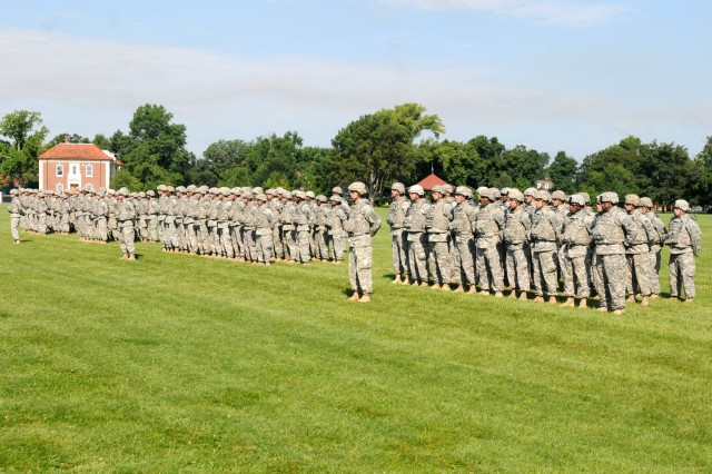 Soldiers of the 233rd Transportation Company stand in formation as they prepare to case their unit colors during a ceremony here, July 13. The 233rd Trans. Co. will deploy to Kuwait in support of Operation New Dawn to conduct stability and support operations. Since 2003, the 233rd Trans. Co. has deployed 6 times in support operation Iraqi Freedom. (U.S. Army photo by Sgt. Michael Behlin)