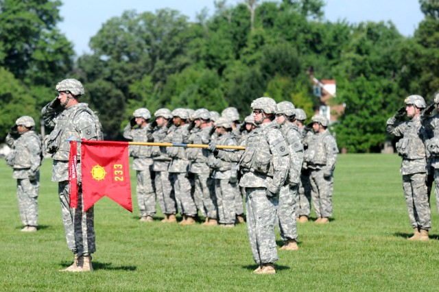 Soldiers of the 233rd Transportation Company salute the colors during a casing ceremony here, July 13. The 233rd Trans. Co. will deploy to Kuwait in support of Operation New Dawn to conduct stability and support operations. Since 2003, the 233rd Trans. Co. has deployed 6 times in support operation Iraqi Freedom. (U.S. Army photo by Sgt. Michael Behlin)