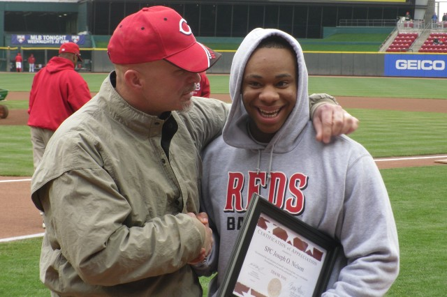 "Michael Boyd, ""Thank You Foundation,"" (L) and Spc. Joseph Nelson, 396th Engineer Company, at the Cincinnati Reds' Great American Ball Park shortly after Boyd presented Nelson with a Certificate of Appreciation from the foundation for his service and sacrifice to the country on May 4, 2011. Nelson suffered a concussion and a knee injury after his Husky route-clearance vehicle hit a roadside bomb during a mission last year in Afghanistan. The Cincinnati Reds also made Nelson an honorary captain that same day prior to their game against the Houston Astros."