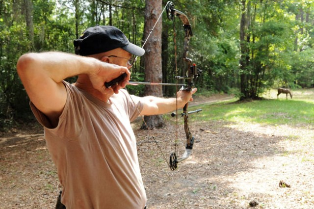 Larry Cornell, Fort Rucker Archery Club president, lines up his shot on a 3-D target at the Fort Rucker Archery Range July 7. The Archery Club presents the Southeast Alabama 3-D Archery Shoot Saturday, July 16 beginning at 9 a.m. Registration is at 8 a.m.