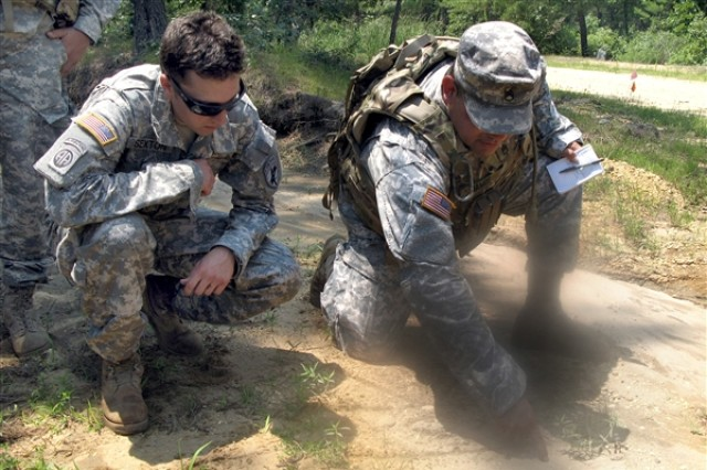 Staff Sgt. Paul Ramos, right, and Army Sgt. Joseph Sexton, Army Reservists with the 425th Civil Affairs Battalion from Encino, Calif., diagram an engagement their civil affairs team is about to conduct during pre-deployment training at Joint Base McGuire-Dix-Lakehurst, N.J., July 7, 2011.