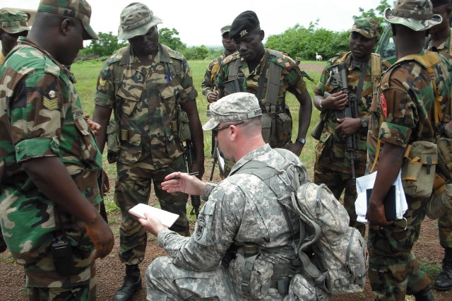 U.S. Army Africa Sgt. 1st Class Grady Hyatt leads an after action review with soldiers of the Ghana Army. Hyatt and 1st Lt. Salvatore Buzzurro worked with Ghanaian troops as part of the ongoing Africa Contingency Operations Training and Assistance program known as ACOTA to prepare for possible future United Nations deployments.