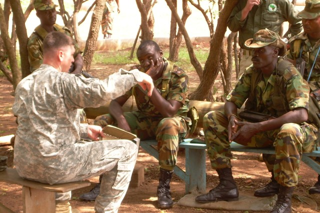 U.S. Army Africa 1st. Lt. Salvatore Buzzurro  holds a class on patrol tactics with Ghanaian soldiers.